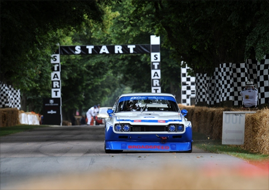 The JD Classics Ford Cologne Capri powers up the iconic Goodwood hill.