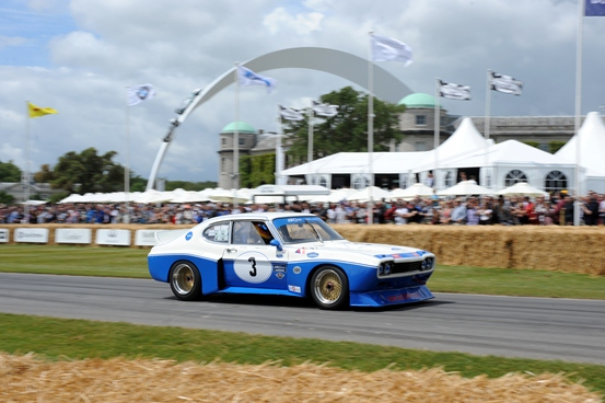 The Ford Cologne Capri powers past Goodwood House.