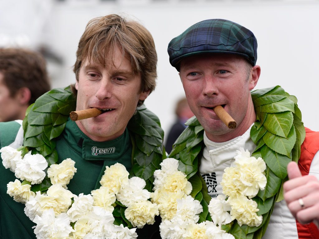 Chris Ward and Gordon Shedden celebrate claiming the prestigious RAC TT Celebration title at this year's Goodwood Revival
