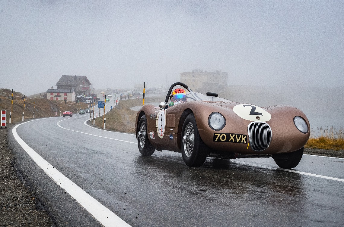 The JD Classics C-Type of Chris Ward pulls away from the start point in the first of four timed runs up the Bernina Pass.