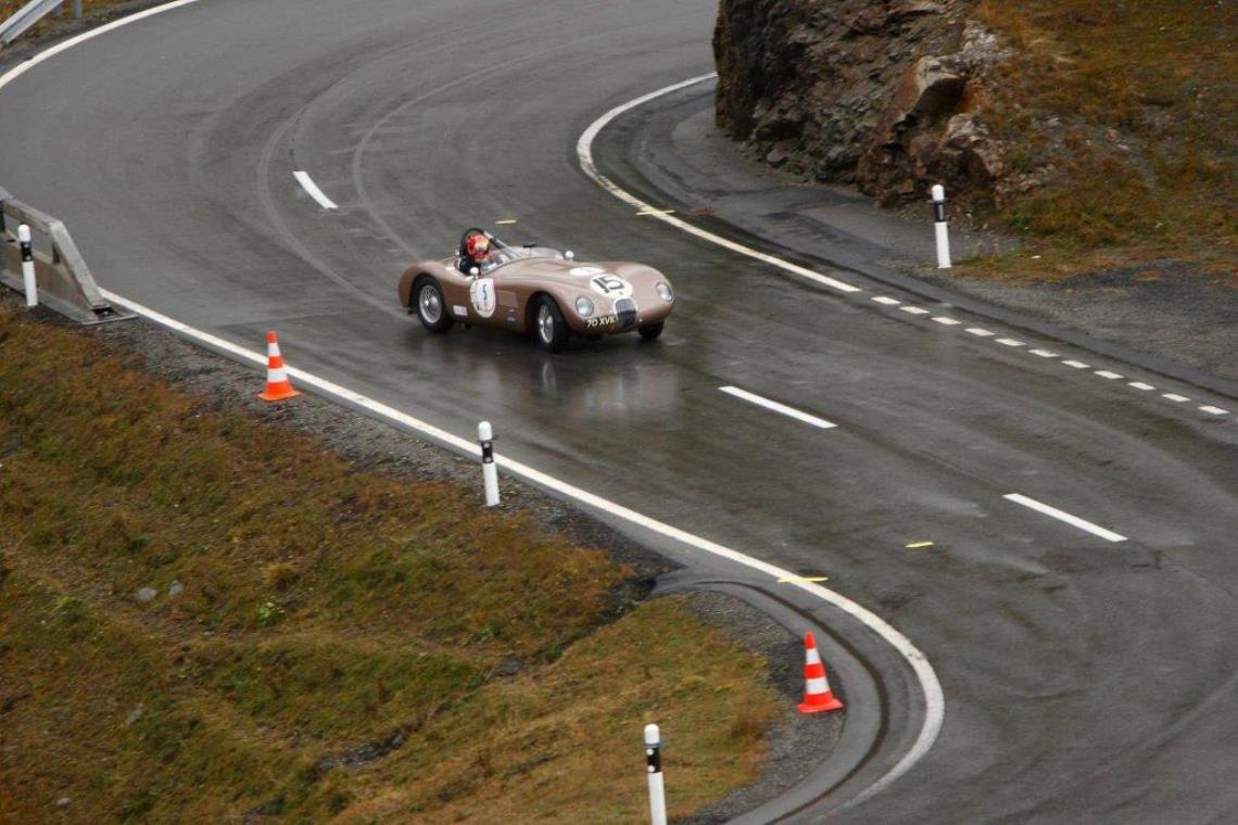 The Jaguar C-Type of Chris Ward tackles the winding mountain pass to finish second overall in the 2015 Bernina Granturismo