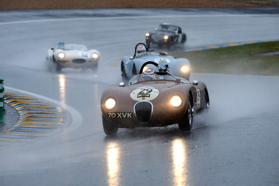 Alex Buncombe battled some precarious weather conditions to dominate Plateau 2 with a double victory in the ex-Fangio C-Type.
