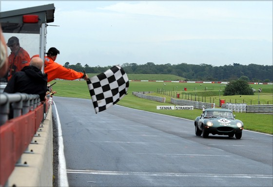 The JD Classics E-Type takes the chequered flag in an unrivalled victory in the 3-Hour Race.