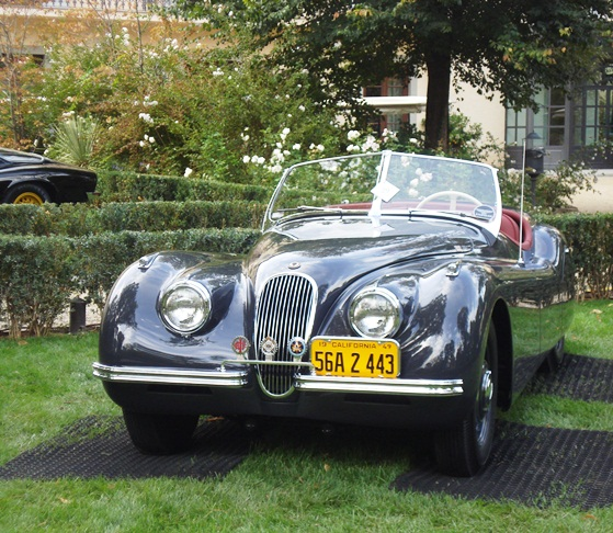 The ex-Clark Gable XK120 on display within the Four Season's vast gardens
