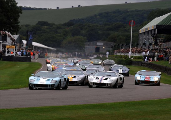 Andy Wallace gets a strong start off the grid for the Whitsun Trophy race as he leads the pack of GT40s off the line
