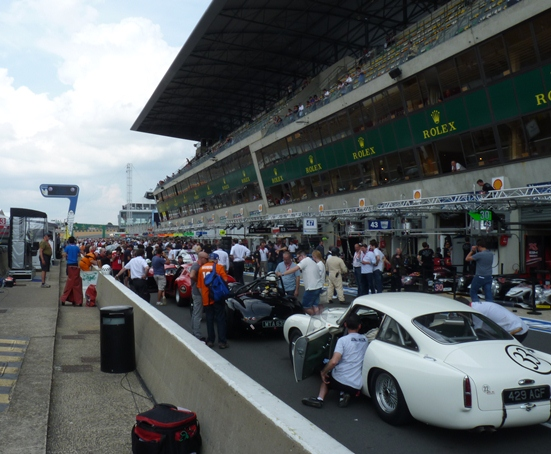 The Le Mans Legend field congregate in the pitlane ahead of the start of the support race