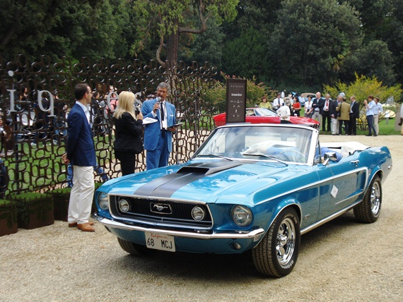 The 1968 Ford Mustang GT Convertible in front of the judging panel