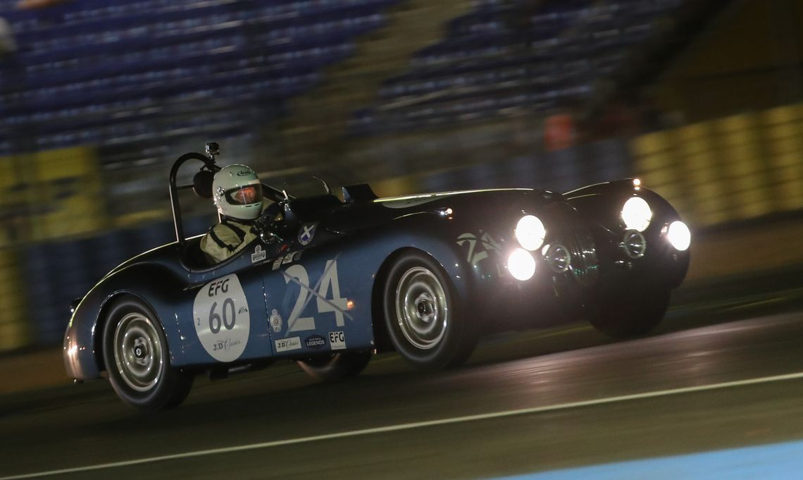 The Ecurie Ecosse Jaguar XK120 contends the challenging circuit during one of the night races